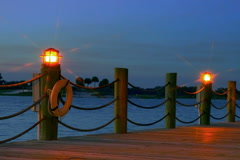 Lamps along lake boardwalk.  Dusk, lens flare Stock Footage