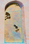 doors to basilica of santa maria degli angeli e dei martiri in rome - stock photo