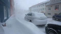 Deep blizzard snowdrifts blocking sidewalk cars street in residential whiteout Stock Footage