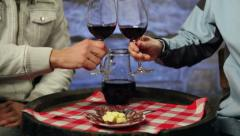 Two men enjoying home made red wine and snack in a cellar. Stock Footage