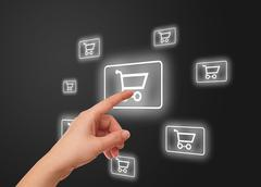 hand pressing shopping cart icon - stock photo
