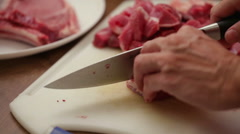 Butcher slicing beef steak onto small chunks - close up Stock Footage