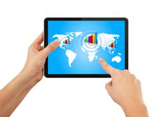 Hand pushing stock growth on tablet with blue earth map - stock photo