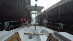 Captain working on boat deck, giving orders to crew, yachting Stock Footage
