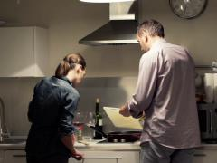 Young couple cooking in kitchen at home at home PAL - stock footage