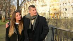 Young model couple in love walking in city - park - sunny Stock Footage