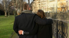 Young model couple in love walking in city - park - shot from back Stock Footage