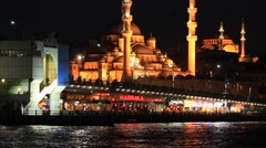 Galata Bridge and Yeni Mosque at Night in Istanbul Stock Footage