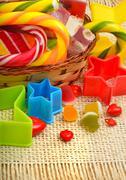 Caramels, lollipops, liquorice, turkish sweet in the basket Stock Photos