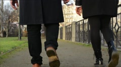 Happy couple walk in city - shot on legs Stock Footage