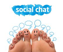 Happy group of finger smileys with social chat sign Stock Photos