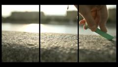Drawing with chalk on the pavement on a sunny day (installation of three video) Stock Footage