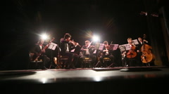 the orchestra plays on stage - stock footage