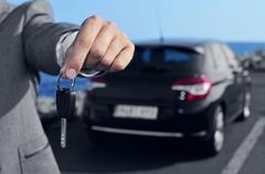 Man offering a car key to the observer Stock Photos