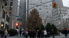 Time Lapse of Rockefeller Christmas Tree Lite Up with people walking by Stock Footage
