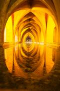 Alcazar queen bath, front view seville, andalusia, spain Stock Photos