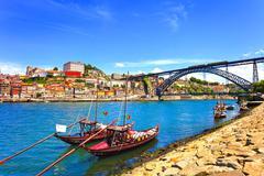 oporto or porto skyline, douro river, boats and iron bridge. portugal, europe - stock photo