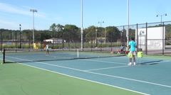 People playing tennis in Queens Stock Footage