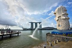 Merlion Statue and Marina Bay Sands Building in Singapore City, Singapore Stock Photos