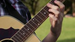 Strumming guitar Stock Footage