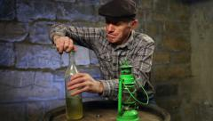 Man lighting up an old oil lamp Stock Footage