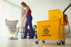 woman doing chores cleaning floor at home focus on bucket - stock photo