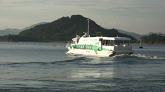 Passenger Ferry Boat Sails By Mountain Island 4K Stock Footage