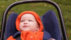 An infant child in the avtolyulka, playing, talking Stock Footage