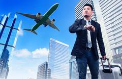 Business man and big belonging luggage watching to sky and hand watch time ag Stock Photos
