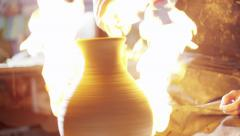 Stock video footage fire and pitcher pottery Stock Footage