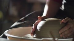Stock video footage potter at the potter's wheel forming wet clay Stock Footage