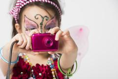 little girl taking snapshot picture - stock photo