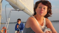 Woman feeling sad after a fight with partner, yachting, tourism Stock Footage