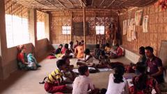Wide room shot children studying village school India Stock Footage