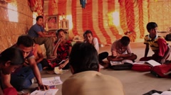 Circle of kids studying moving shot village school India Stock Footage
