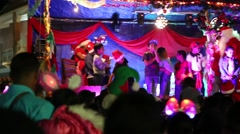 Children Onstage with Santa Clause (Papa Noel) at Christmas Festival Stock Footage