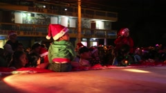 Children With Lighted, Strobing Christmas Hats Sit on Stage with Santa Stock Footage
