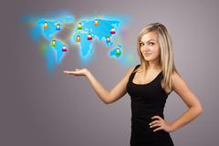 Young woman holding virtual map - stock photo