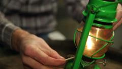 Man lighting an old oil lamp Stock Footage