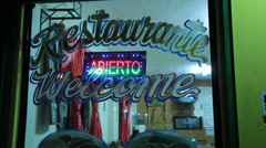 "Neon Open ""Abierto"" Sign in Restaurant Window Stock Footage"