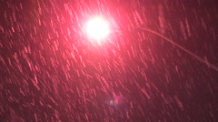 Heavy snow falling at night in the city Stock Footage