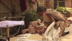 Old woman sorting rice India village Stock Footage