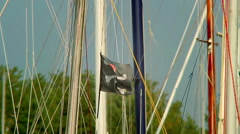 Stock Video Footage of Black pirate flag on the wind, skull and crossbones, yachting