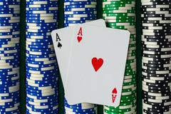 pair of aces on a rows of betting poker chips - stock photo