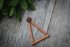 Cinnamon sticks shaped as a christmas tree on wood background Kuvituskuvat