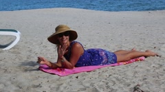 Happy Attractive Woman on Beach Raises Hands and Legs Stock Footage