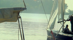 Family leaving dock in small sailing yacht, vacation, holiday Arkistovideo