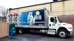 Polar bear beverages delivery truck Stock Footage