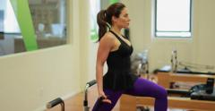 Young adult hispanic caucasian woman working out in a gym - stock footage