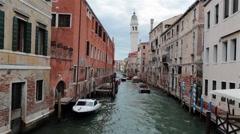 Stock Video Footage of Venice Italy neighborhood canal boat mooring HD 3991